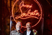 Jean-Paul Favand and Christian Louboutin attend the Loubicircus Party by Christian Louboutin at Musee des Arts Forains as part of Paris Fashion Week on June 19, 2019 in Paris, France.