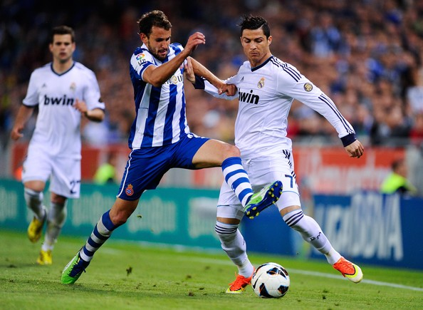 Christian Stuani Cristiano Ronaldo of Real Madrid CF duels for the  Christian Stuani of RCD Espanyol during the La Liga match between RCD Espanyol and Real Madrid CF at Cornella-El Prat Stadium on May 11, 2013 in Barcelona, Spain.