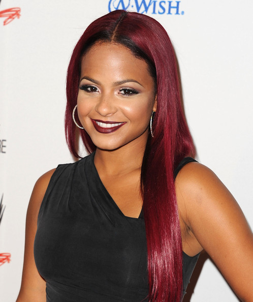 Arrivals at WWE's 'Superstars for Hope' Event [e presents ``superstars for hope,hair,hairstyle,eyebrow,red,hair coloring,beauty,human,chin,forehead,wig,arrivals,christina milian,superstars for hope,beverly hills hotel,california,wwe,e entertainment]