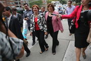 Democratic mayoral candidate Christine Quinn (L) and her wife Kim Catullo depart a polling station after casting their votes in the primary election for New York City mayor on September 10, 2013 in the Manhattan borough of New York City. Quinn, trailing in the polls, is hoping to garner enough votes to compete in a runoff election to be the Democratic candidate.