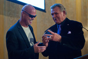 """Jim McMahon and Mike Ditka attend The Christopher & Dana Reeve Foundation's """"A Magical Evening Chicago"""" at Peninsula Hotel on October 22, 2015 in Chicago, Illinois.  (Photo by Timothy Hiatt/Getty Images for The Christopher & Dana Reeve"""