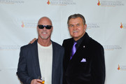 """Jim McMahon and Mike Ditka attend The Christopher & Dana Reeve Foundation's """"A Magical Evening Chicago"""" at Peninsula Hotel on October 22, 2015 in Chicago, Illinois."""