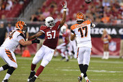 Quarterback Jason Campbell #17 of the Cincinnati Bengals throws past linebacker Alex Okafor #17 of the Arizona Cardinals during the preseason NFL game at University of Phoenix Stadium on August 24, 2014 in Glendale, Arizona.
