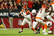 Quarterback Andy Dalton #14 of the Cincinnati Bengals is hit by outside linebacker Alex Okafor #57 of the Arizona Cardinals during the first quarter of the NFL game at the University of Phoenix Stadium on November 22, 2015 in Glendale, Arizona.
