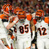 Andy Dalton Tyler Eifert Photos - Tight end Tyler Eifert #85 of the Cincinnati Bengals (center) celebrates his fourth quarter touchdown with quarterback Andy Dalton #14 (left) and wide receiver Mohamed Sanu #12 (right) during the NFL game against the Arizona Cardinals at the University of Phoenix Stadium on November 22, 2015 in Glendale, Arizona. - Cincinnati Bengals v Arizona Cardinals