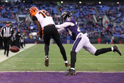 Cornerback Brandon Carr #24 of the Baltimore Ravens breaks up a pass to wide receiver A.J. Green #18 of the Cincinnati Bengals in the first quarter at M&T Bank Stadium on December 31, 2017 in Baltimore, Maryland.