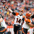 Quarterback Andy Dalton #14 of the Cincinnati Bengals passes during the first half against the Cleveland Browns at FirstEnergy Stadium on December 6, 2015 in Cleveland, Ohio.