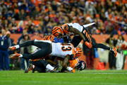 Wide receiver Demaryius Thomas #88 of the Denver Broncos is hit by a trio of Cincinnati Bengals defensive players, including George Iloka #43 and Shawn Williams #36 after a catch during a game at Sports Authority Field at Mile High on November 19, 2017 in Denver, Colorado.