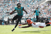 Chris Ivory #33 of the Jacksonville Jaguars runs with the football over  Vontaze Burfict #55 of the Cincinnati Bengals during the first half of their game at EverBank Field on November 5, 2017 in Jacksonville, Florida.