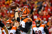 Andy Dalton #14 of the Cincinnati Bengals rolls out of the pocket and throws a pass during the second quarter of the game against the Kansas City Chiefs at Arrowhead Stadium on October 21, 2018 in Kansas City, Kansas.