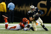 Jimmy Graham #80 of the New Orleans Saints with a reception against  Emmanuel Lamur #59 of the Cincinnati Bengals during the first quarter at Mercedes-Benz Superdome on November 16, 2014 in New Orleans, Louisiana.