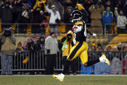 Antonio Brown #84 of the Pittsburgh Steelers celebrates while scoring on a 67 yard punt return against the Cincinnati Bengals during the game on December 15, 2013 at Heinz Field in Pittsburgh, Pennsylvania.