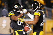 Antonio Brown #84 of the Pittsburgh Steelers celebrates his first quarter punt return for a touchdown with Will Allen #20 while playing he Cincinnati Bengals at Heinz Field on December 15, 2013 in Pittsburgh, Pennsylvania.