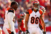 James Wright #86 and  Brandon Thompson #98 of the Cincinnati Bengals  react to a play during a game against the Tampa Bay Buccaneers  at Raymond James Stadium on November 30, 2014 in Tampa, Florida.