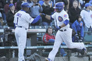 Welington Castillo #5 of the Chicago Cubs is greeted by Gary Jones #1 after hitting a two-run home run against the Cincinnati Reds during the seventh inning on April 19, 2014 at Wrigley Field in Chicago, Illinois.