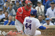 Curt Casali #12 of the Cincinnati Reds tags out Anthony Rizzo #44 of the Chicago Cubs at home plate in the fourth inning at Wrigley Field on May 26, 2019 in Chicago, Illinois.