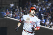 Joey Votto #19 of the Cincinnati Reds runs the bases after hitting a home run against the Chicago Cubs during the fourth inning on September 14, 2018 at Wrigley Field  in Chicago, Illinois.