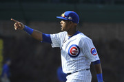 Starlin Castro #13 of the Chicago Cubs celebrates the Cubs win against the Cincinnati Reds on April 19, 2014 at Wrigley Field in Chicago, Illinois.  The Chicago Cubs defeated the Cincinnati Reds 8-4.