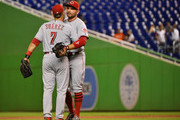 Eugenio Suarez #7 and Joey Votto #19 of the Cincinnati Reds celebrate the win against the Miami Marlins at Marlins Park on September 20, 2018 in Miami, Florida.