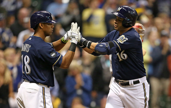 Aramis Ramirez #16 of the Milwaukee Brewers is greeted by Khris Davis #18 after hitting a home run during the fourth inning of their game against the Cincinnati Reds at Miller Park on September 13, 2014 in Milwaukee, Wisconsin.
