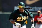 Manny Ramirez #1 of the Oakland Athletics runs the bases against the Cincinnati Reds during a spring training game at the Phoenix Municipal Stadium on March 10, 2012 in Phoenix, Arizona.