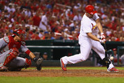 Matt Holliday #7 of the St. Louis Cardinals hits an RBI single against the Cincinnati Reds in the third inning at Busch Stadium on August 18, 2014 in St. Louis, Missouri.