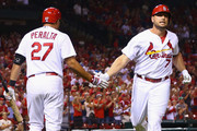 Matt Holliday #7 of the St. Louis Cardinals is congratulated by Jhonny Peralta #27 of the St. Louis Cardinals after hitting a solo him run 1i against the Cincinnati Reds at Busch Stadium on September 19, 2014 in St. Louis, Missouri.