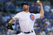 Cole Hamels #35 of the Chicago Cubs pitches on his way to a complete game win over the Cincinnati Reds at Wrigley Field on August 23, 2018 in Chicago, Illinois. The Cubs defeated the Reds 7-1.