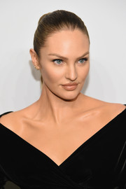 Candice Swanepoel styled her hair into a tight braid for the 'Angels' by Russell James book launch.