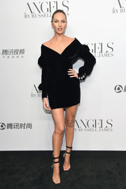 A pair of PVC sandals with double ankle straps sealed off Candice Swanepoel's look.