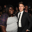 He hangs out at awards shows with Gabourey Sidibe.