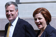 Christine Quinn (R), New York City Council Speaker and former mayoral hopeful, smiles with Democratic Party nominee Bill de Blasio, while entering a news conference where Quinn endorsed de Blasio outside City Hall on September 17, 2013 in New York City. De Blasio will face Republican Joseph Lhota in the general mayoral election November 5, 2013, with the winner succeeding current Mayor Michael Bloomberg.