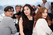 """(L-R) Kim Minhee, Isabelle Huppert and Hong SangSoo attend the """"Claire's Camera (Keul-Le-Eo-Ui-Ka-Me-La)"""" photocall during the 70th annual Cannes Film Festival at Palais des Festivals on May 21, 2017 in Cannes, France."""
