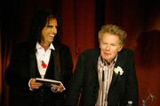 Alice Cooper and Julien Temple  with the Best Film/DVD Awardon stage at the Marshall Classic Rock Roll Honour-Show at The Roundhouse on November 10, 2010 in London, England.