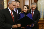 House Veterans Affairs Committee Chairman Jeff Miller (R-FL) (L) shows  (L-R) Ride2Recovery President John Wordin and Clay Hunt's parents Susan Selke and Richard Selke the Clay Hunt Suicide Prevention for American Veterans Act in the Rayburn Room at the U.S. Capitol February 10, 2015 in Washington, DC. A decorated combat veteran of Iraq and Afghanistan, Clay Hunt became a prominent advocate for troops suffering from post-traumatic stress disorder after leaving the Marine Corps and later killed himself in 2011.