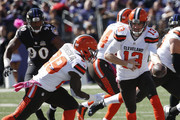 Quarterback Josh McCown #13 of the Cleveland Browns hands the ball off to running back Duke Johnson #29 of the Cleveland Browns while linebacker Za'Darius Smith #90 of the Baltimore Ravens defends in the first quarter of a game at M&T Bank Stadium on October 11, 2015 in Baltimore, Maryland.