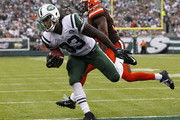 Chris Ivory #33 of the New York Jets scores a touchdown as Donte Whitner #31 of the Cleveland Browns chases during the third quarter of a game at MetLife Stadium on September 13, 2015 in East Rutherford, New Jersey. The Jets won 31-10.