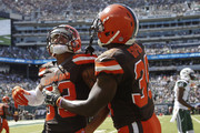 Jordan Poyer #33 and Tashaun Gipson #39 of the Cleveland Browns celebrate after breaking up a pass intended for Brandon Marshall #15 of the New York Jets during the game at MetLife Stadium on September 13, 2015 in East Rutherford, New Jersey.