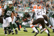 Running back Chris Ivory #33 of the New York Jets carries the ball during the first half against the Cleveland Browns at MetLife Stadium on December 22, 2013 in East Rutherford, New Jersey.