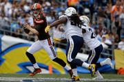 Cleveland Browns quarterback Josh McCown #13 is pressured by Ricardo Mathews #90 and Patrick Robinson #26 of the San Diego Chargers in the first quarter at Qualcomm Stadium on October 4, 2015 in San Diego, California. The Chargers defeated the Browns 30-27.