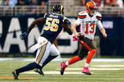 Josh McCown #13 of the Cleveland Browns scrambles while under pressure from Akeem Ayers #56 of the St. Louis Rams in the second quarter at the Edward Jones Dome on October 25, 2015 in St. Louis, Missouri.