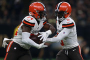 Tyrod Taylor #5 of the Cleveland Browns hands to the ball off to Carlos Hyde #34 of the Cleveland Browns during the second quarter   at Mercedes-Benz Superdome on September 16, 2018 in New Orleans, Louisiana.