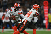 Carlos Hyde #34 of the Cleveland Browns runs the ball as Tyrod Taylor #5 of the Cleveland Browns looks on during the first quarter against the New Orleans Saints  Mercedes-Benz Superdome on September 16, 2018 in New Orleans, Louisiana.