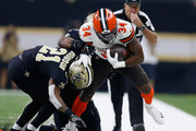 Carlos Hyde #34 of the Cleveland Browns is tackled by Patrick Robinson #21 of the New Orleans Saints during the first quarter at Mercedes-Benz Superdome on September 16, 2018 in New Orleans, Louisiana.