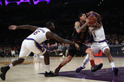 Jordan Clarkson #8 of the Cleveland Cavaliers splits the defense of Kentavious Caldwell-Pope #1 and Lance Stephenson #6 of the Los Angeles Lakers during the second half of a game at Staples Center on January 13, 2019 in Los Angeles, California.  NOTE TO USER: User expressly acknowledges and agrees that, by downloading and or using this photograph, User is consenting to the terms and conditions of the Getty Images License Agreement.