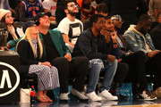 2018 Masters Champion  Patrick Reed (2nd L), looks on with wife Justine, comedian Chris Rock, comedian Aziz Anzari and rapper 2 Chainz during the game between the New York Knicks and the Cleveland Cavaliers at Madison Square Garden on April 9, 2018 in New York City. NOTE TO USER: User expressly acknowledges and agrees that, by downloading and or using this photograph, User is consenting to the terms and conditions of the Getty Images License Agreement.