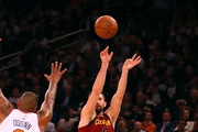 Kevin Love #0 of the Cleveland Cavaliers shoots in the first half against Kyle O'Quinn #9 of the New York Knicks at Madison Square Garden on April 9, 2018 in New York City. NOTE TO USER: User expressly acknowledges and agrees that, by downloading and or using this photograph, User is consenting to the terms and conditions of the Getty Images License Agreement.