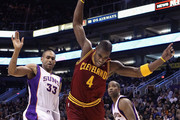 Antawn Jamison #4 of the Cleveland Cavaliers loses the ball as he drives past Grant Hill #33 and Michael Redd #22 of the Phoenix Suns during the NBA game at US Airways Center on January 12, 2012 in Phoenix, Arizona.  NOTE TO USER: User expressly acknowledges and agrees that, by downloading and or using this photograph, User is consenting to the terms and conditions of the Getty Images License Agreement.