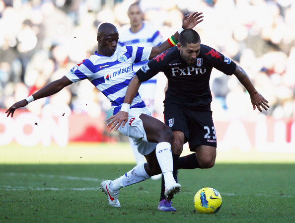 Clint Dempsey Samba Diakite of Queen Park Rangers tackles Clint Dempsey of Fulham during the Barclays Premier League match between Queens Park Rangers and Fulham at Loftus Road on February 25, 2012 in London, England.