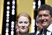 Emily Beecham and Antonio Banderas pose on stage with their awards at the Closing Ceremony during the 72nd annual Cannes Film Festival on May 25, 2019 in Cannes, France.
